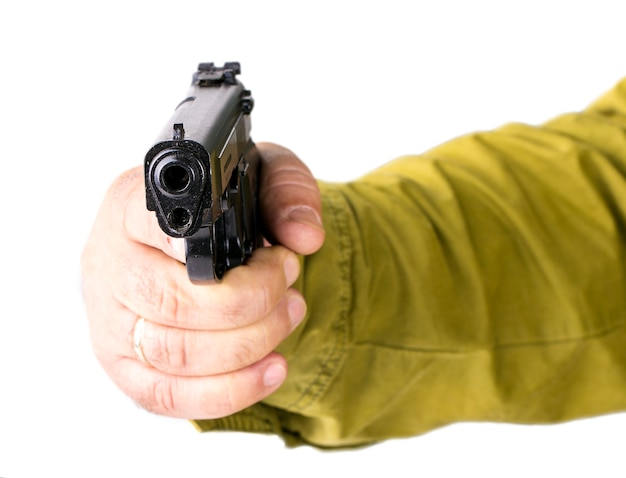 Hand with pistol isolated on white Premium Photo