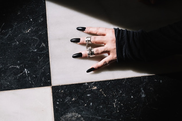 Hand with rings and long nails Free Photo