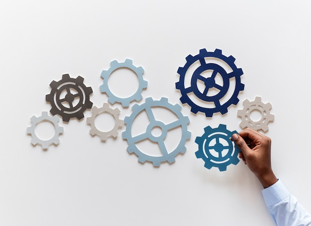 Hand with support gears isolated on white background Premium Photo