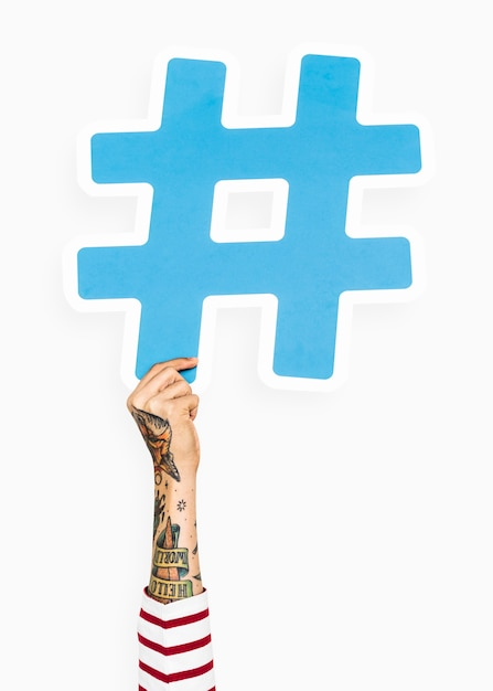 Hand With Tattoo Holding Hashtag Icon Photo