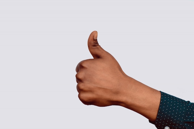 Hand with thumbs up Premium Photo