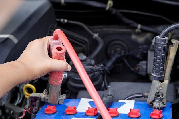 Hand of woman checking engine of car maintenance Premium Photo
