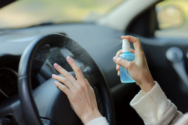 Premium Photo | Hand of woman is spraying alcohol, disinfectant spray in car,  safety, prevent infection of covid 19 virus, coronavirus, contamination of  germs or bacteria. alcohol sanitizer,hygiene concept.