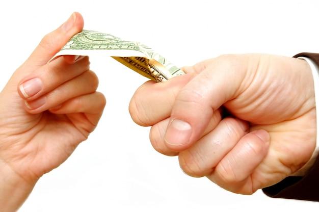 Hand wringing a bill Free Photo