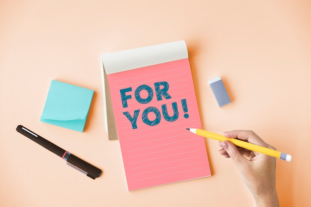 Hand writing for you on a notepad Premium Photo