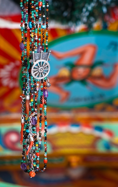 Handcrafted jewelry inspired by the sicilian cart Premium Photo