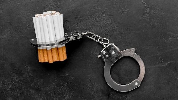 Handcuffs with cigarettes Free Photo