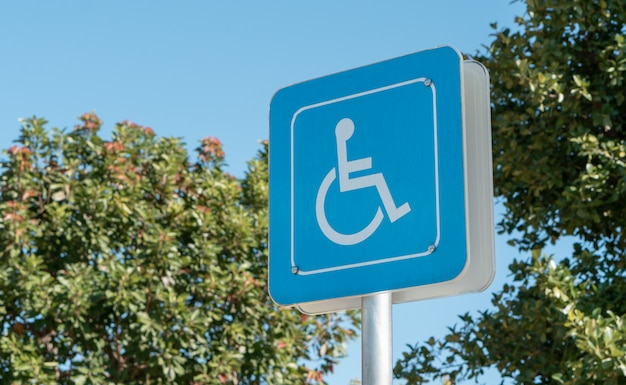 Handicapped icon on the ground of car parking area reserve for disabled people in urban gas station Premium Photo