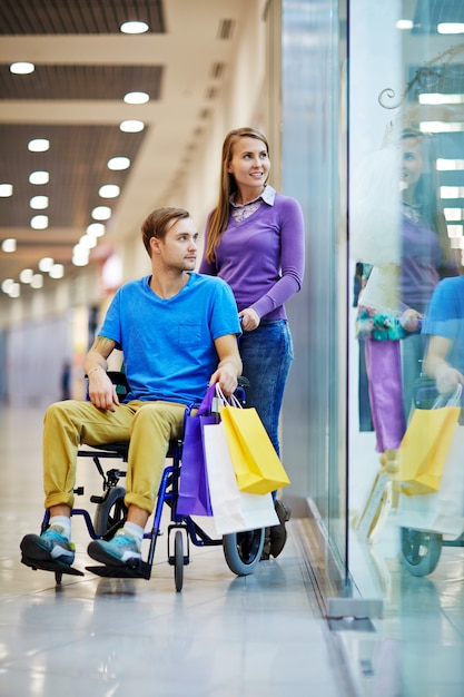Handicapped man shopping Free Photo