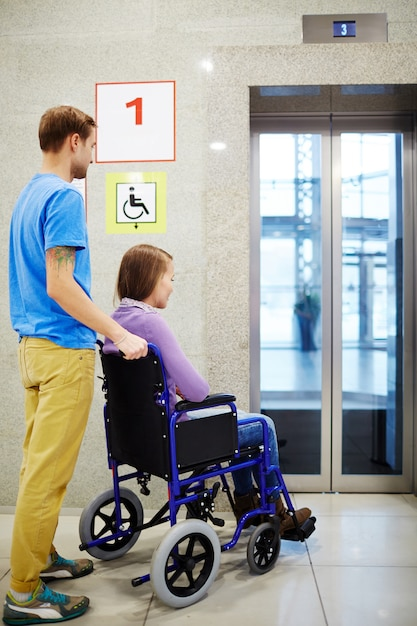 Handicapped waiting for elevator Free Photo