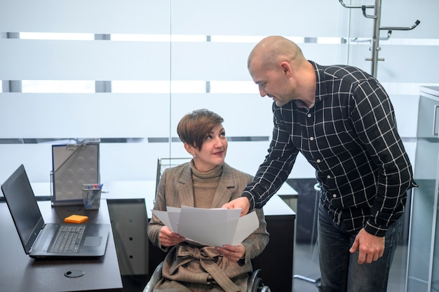 Handicapped young woman in office with a man Free Photo