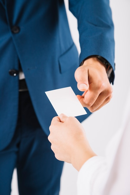 Handing over business card Photo | Free Download