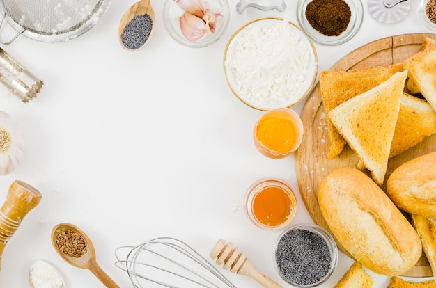 Handmade bread with ingredients and utensil kitchen Free Photo