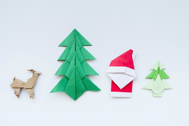 Handmade christmas tree; reindeer; santa claus paper origami isolated on white backdrop Free Photo