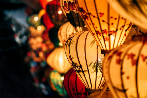 Handmade colorful lanterns at the market street of hoi an ancient town, unesco world heritage site in vietnam. Premium Photo