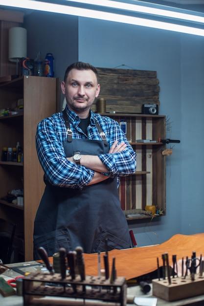 Handmade craft production of leather goods. Premium Photo