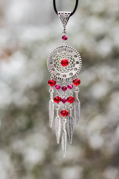 Handmade dream catcher with feathers threads and beads rope hanging Premium Photo