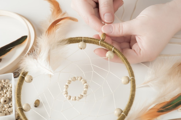 Handmade dream catcher with feathers Premium Photo