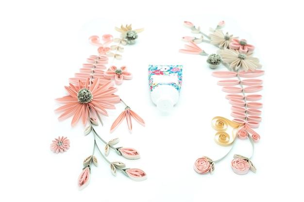 ็handmade festive decoration with paper flowers on white background Premium Photo