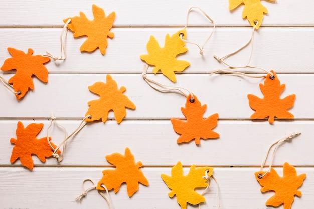 Handmade maple leaves on white background Free Photo