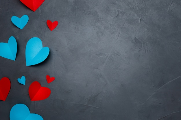 Handmade paper hearts on gray textured background Free Photo