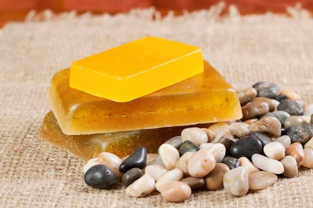 Handmade soap and sea pebbles Premium Photo