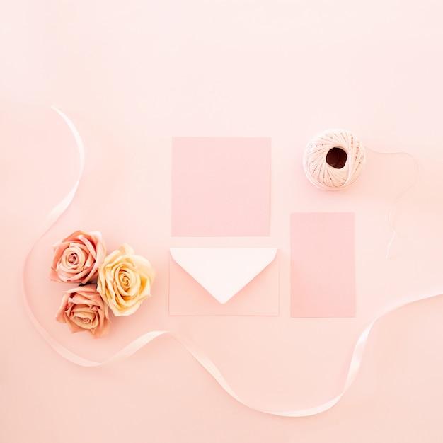 Handmade wedding invitation with coral tones Free Photo