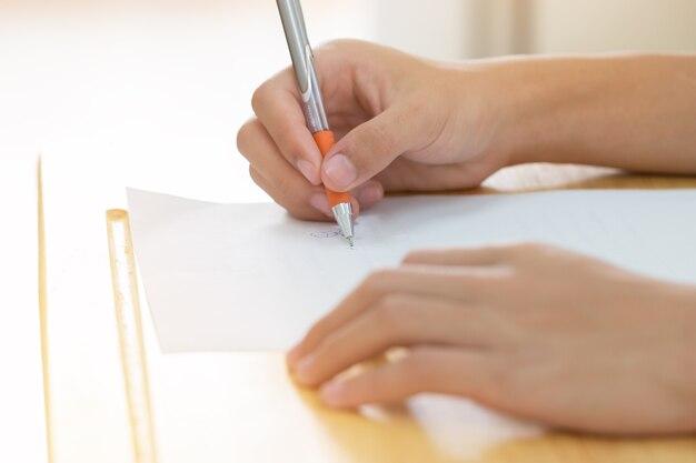 Hands asian students thai uniform holding pen Premium Photo