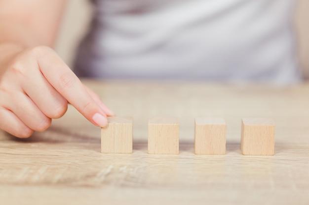 Hands of business,stacking wooden blocks. Premium Photo