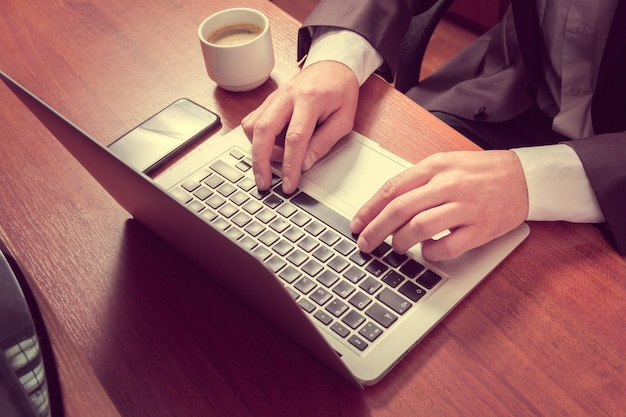 Hands businessman on a laptop Premium Photo