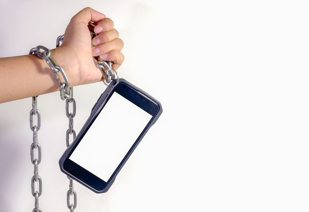 Hands chained holding smartphone.it is indispensable in daily life. Premium Photo
