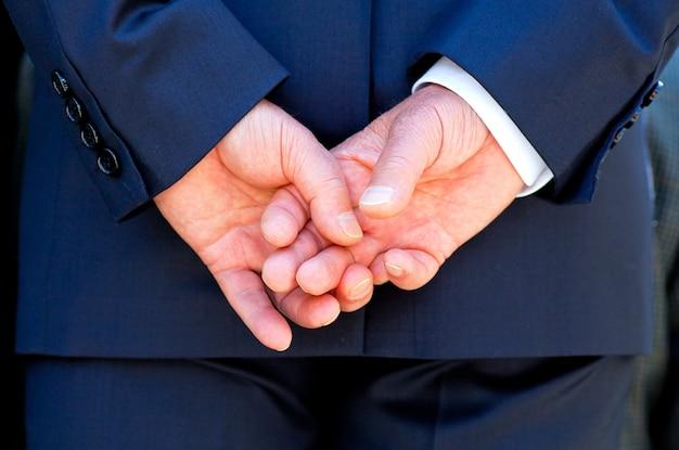 Hands clasped Premium Photo
