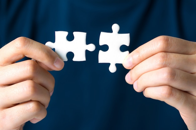 Hands connecting jigsaw puzzle. business solutions, success and strategy concept. Premium Photo