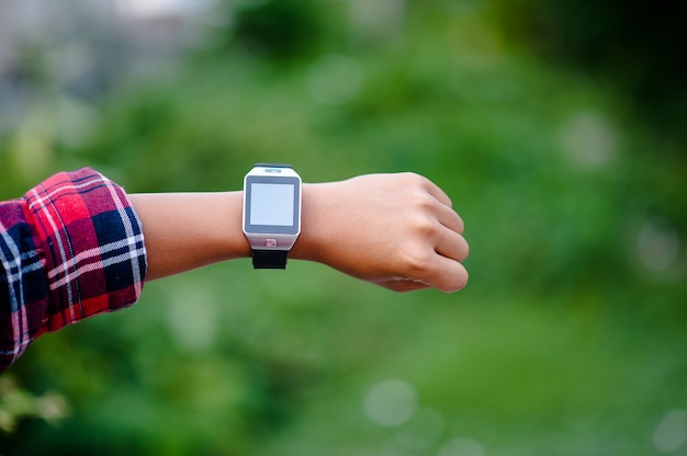 Hands and digital watches of boys watch the time in the wrist. the orientation is punctual. Premium Photo
