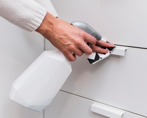 Hands disinfecting furniture handles Free Photo