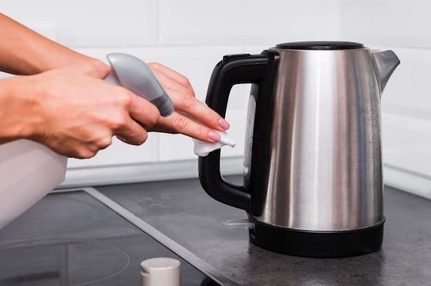 Hands disinfecting kettle Free Photo