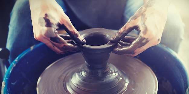 Hands doing some pottery work Premium Photo