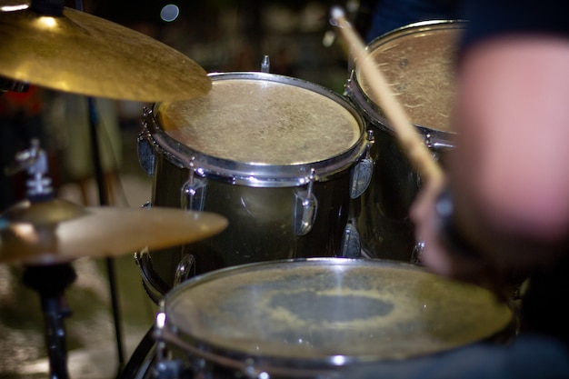 Hands of drummer with sticks and drums close-up Premium Photo