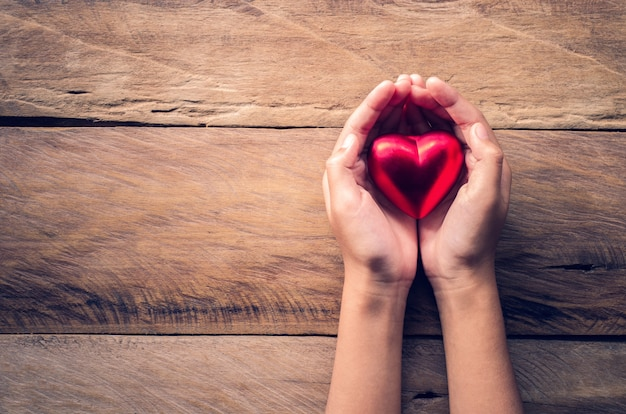 Hands female giving red heart Premium Photo