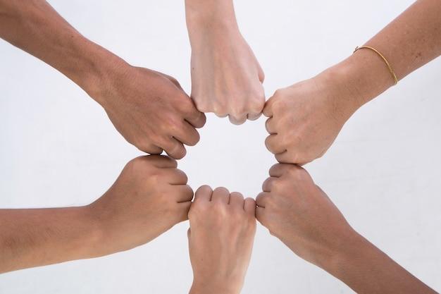 Hands of fist bump together make an achievement Premium Photo