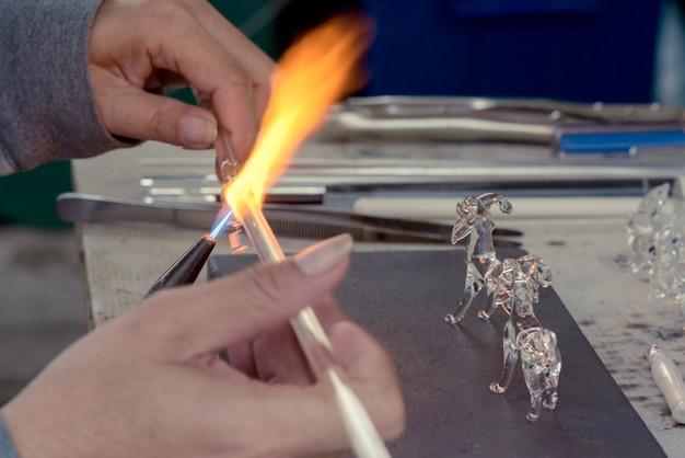 Hands of the handicrafts man making animal grass Premium Photo
