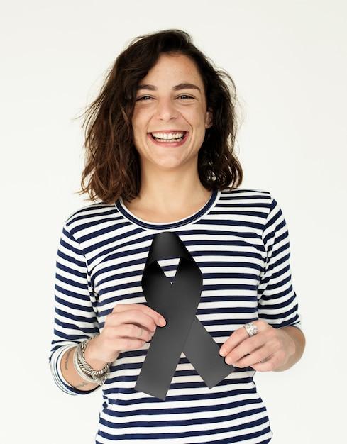 Hands hold black ribbon mourning Premium Photo