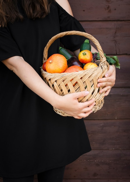 Hands holding basket with vegetables Free Photo