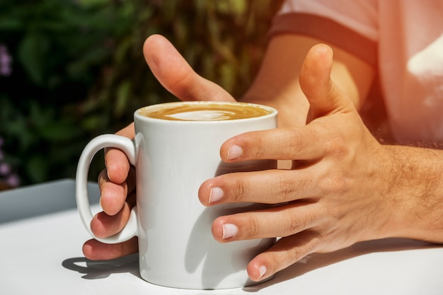 Hands holding cup of coffee Free Photo