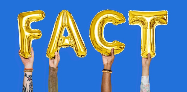Hands holding fact word in balloon letters Premium Photo