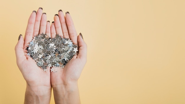 Hands holding glitter with copy space flat lay Free Photo