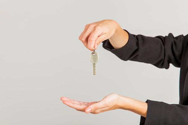 Hands holding keys Free Photo