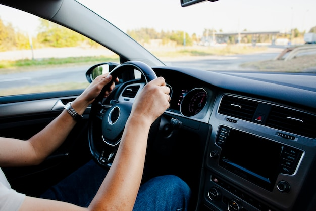 Hands holding modern car wheel Free Photo