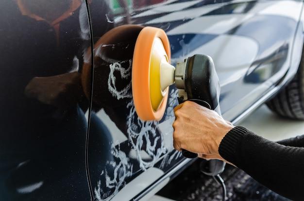 Hands holding polish car Premium Photo