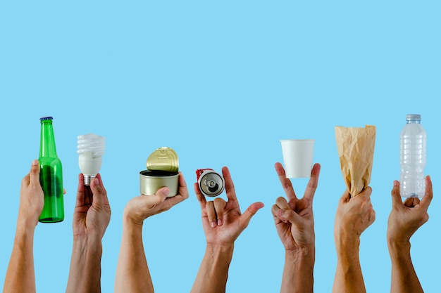 Hands holding and show recycle materials on blue Premium Photo